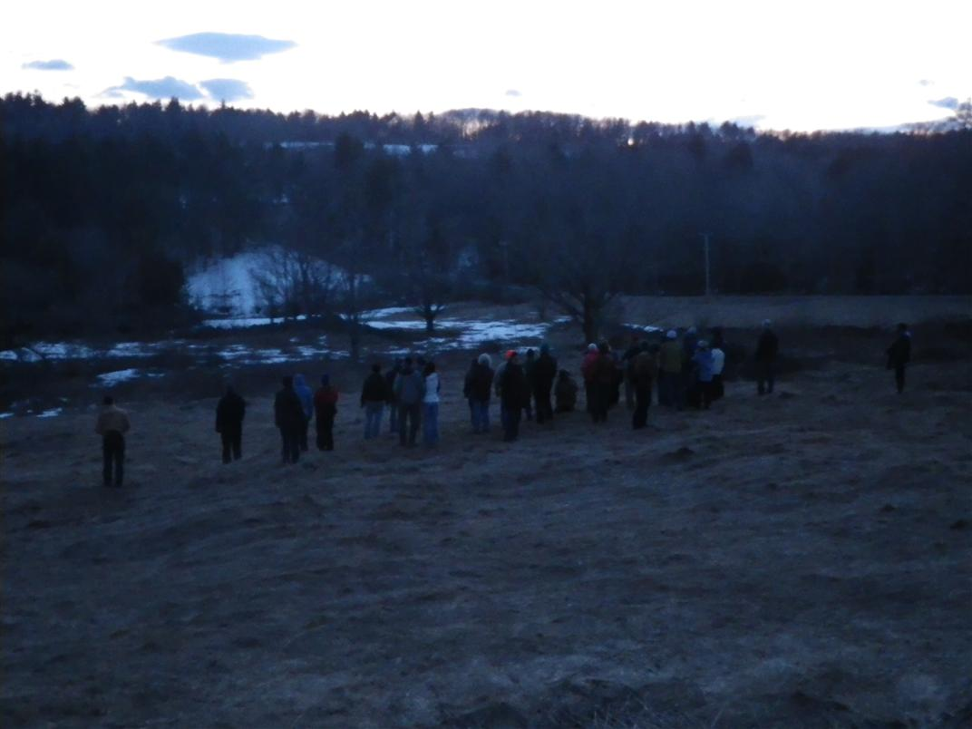 Volunteers enjoy a free woodcock watching program on conserved land in early spring.