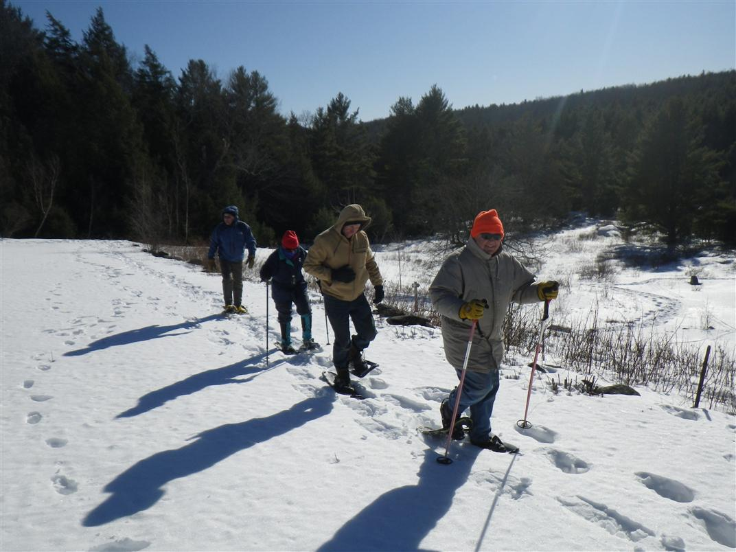 Volunteers follow a property boundary at a training on FLT's 150 acre Guyette Farm property.